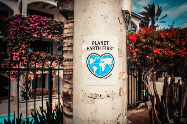 For Earth Day 2021 planet earth first sign on pole.